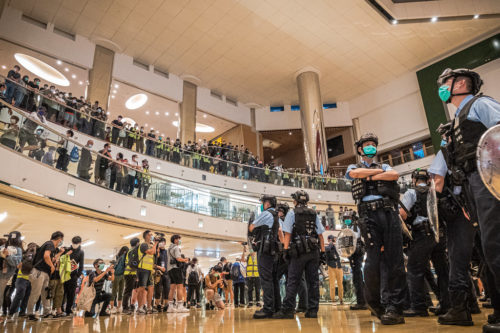 Police face protesters at Hong Kong's City Plaza Mall