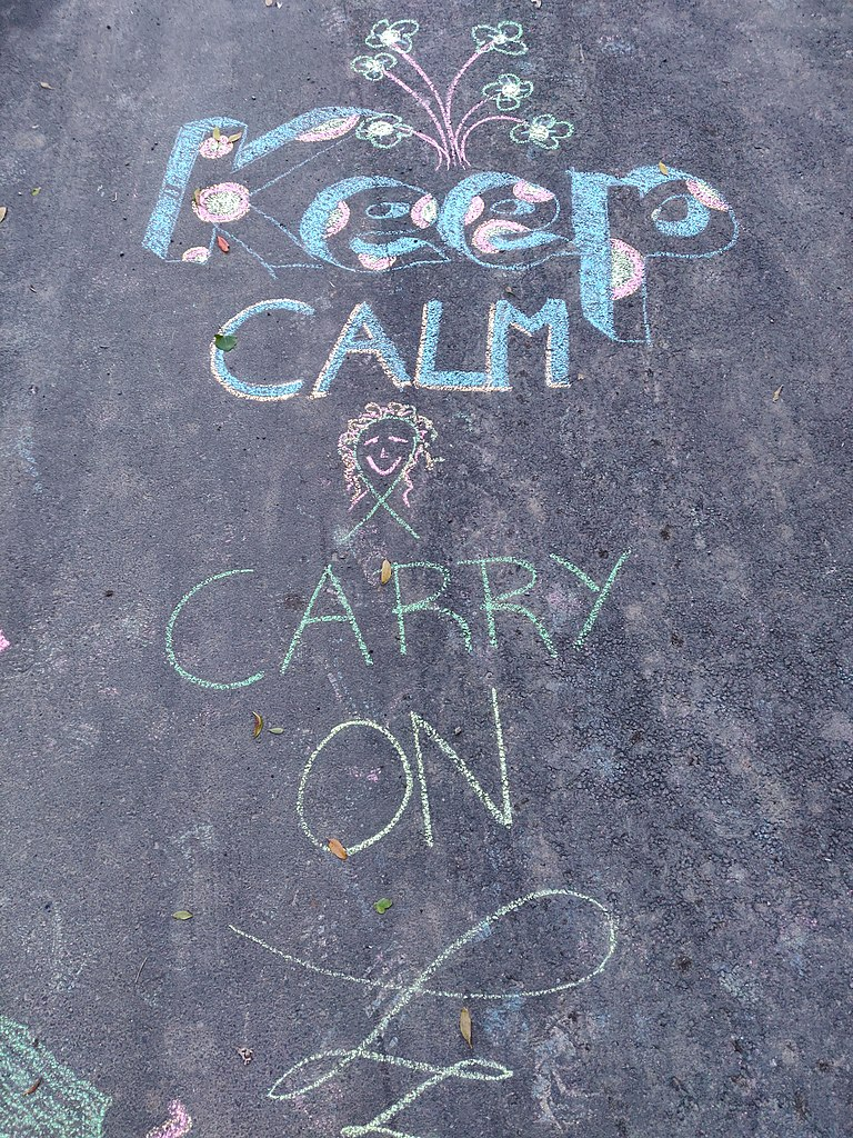 A chalk message saying 'arohanui' on the pavement in Island Bay during COVID-19.
