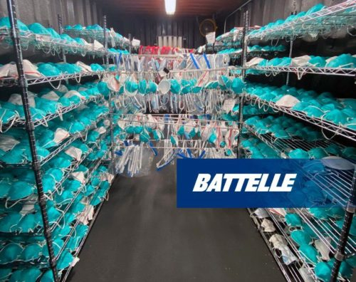 Masks inside Battelle's mask cleaning device, ready to be sanitized.