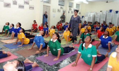 Children perform yoga at the Naval Children School, Mumbai in 2015