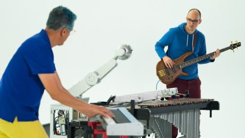 Gil Weinberg and Richard Savery play with Shimon, the musical robot.