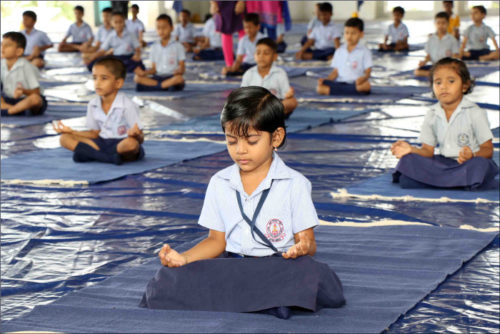 Students of Naval Children School and Naval Kindergarten, Ezhimala participating in the mass yoga demonstration at Indian Naval Academy to commemorate the 3rd International Yoga Day 2017.