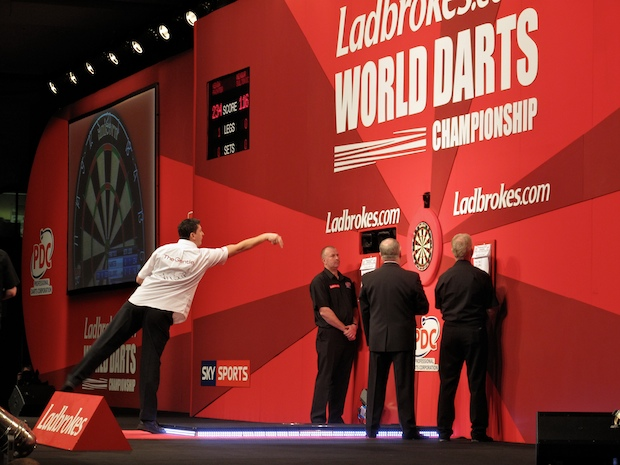 the Gentle Giant, Mensur Suljovic throws a dart at the PDC World Championships.