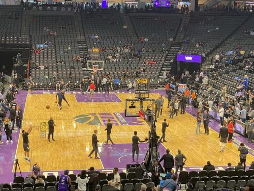Sacramento Kings players shoot around after the game is postponed on March 11.