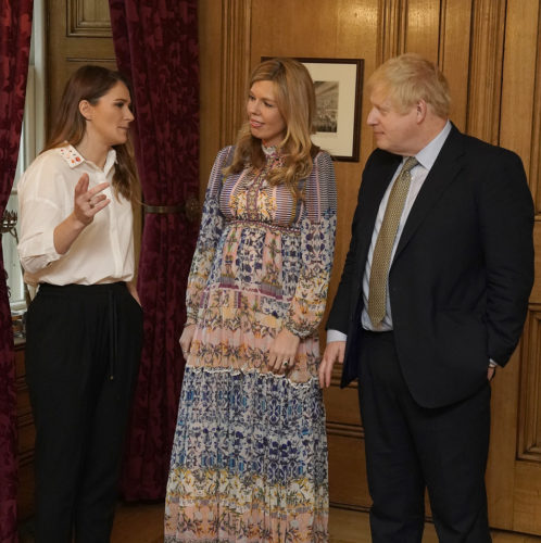 The Prime Minister Boris Johnson and his partner Carrie Symonds talk to Lizzie Carr the winner of the Points of Light Award at International Woman's Day at No 10 Downing Street.