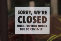 SORRY, WE'RE CLOSED UNTIL FURTHER NOTICE DUE TO COVID-19, sign on business on North Charles Street in Baltimore, Maryland
