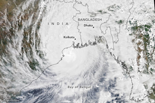 Satellite image of Cyclone Amphan with a map of India and Bangladesh laid over it.