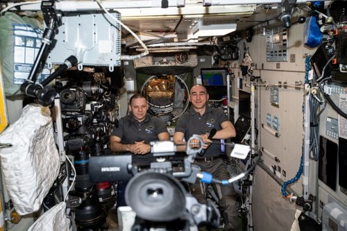 Roscosmos cosmonauts and Expedition 63 Flight Engineers (from left) Ivan Vagner and Anatoly Ivanishin record a public affairs event for Russian media from the International Space Station's Zvezda service module.