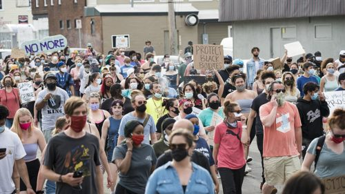 On May 26, 2020, people protested against police violence after the death of George Floyd. Large crowd of protesters in a street.