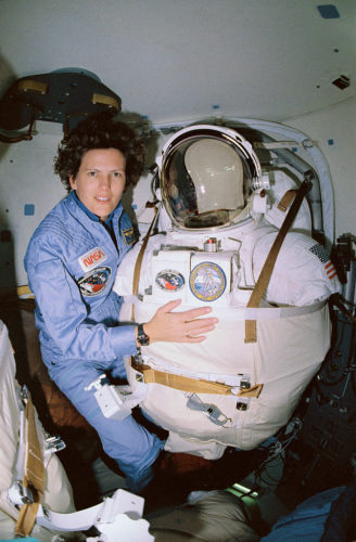 Kathryn D. Sullivan poses for a picture before donning her space suit and extravehicular mobility unit