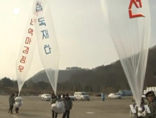 Balloon release by South Korean activists. Activists are likely members of the North Korean People's Liberation Front.