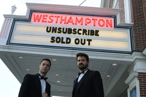 Eric Tabach and Christian Nilsson in front of the movie theater showing their movie, Unsubscribe.