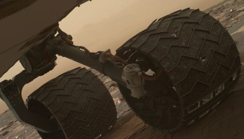 Two of the raised treads, called grousers, on the left middle wheel of NASA's Curiosity Mars rover broke during the first quarter of 2017, including the one seen partially detached at the top of the wheel in this image from the Mars Hand Lens Imager (MAHLI) camera on the rover's arm.