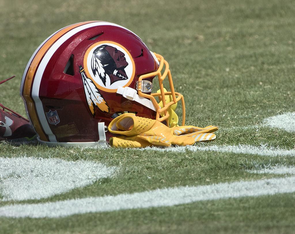 Washington Redskins helmet on field.