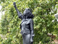 Statue of activist Jen Reid, in place on the plinth that formerly held the statue of Edward Colston.