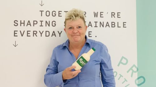 Helle Høst-Madsen, leader of Paboco, holds one of the paper bottles the company is developing with the beer company Carlsberg.
