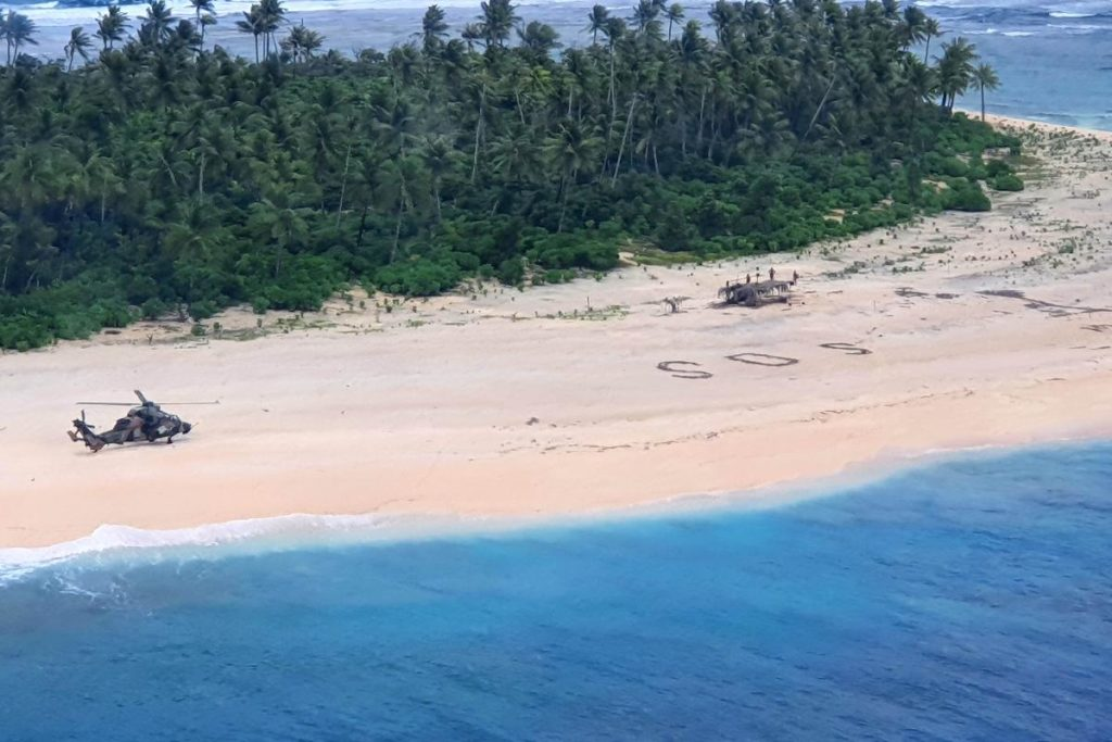 Aerial view of Australian helicopter on beach next SOS.