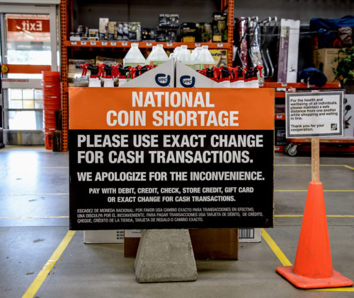 The national coin shortage hits Southern California, blamed on virus-related slowdowns of U.S. mints. This sign is in a Home Depot store in Upland, California.