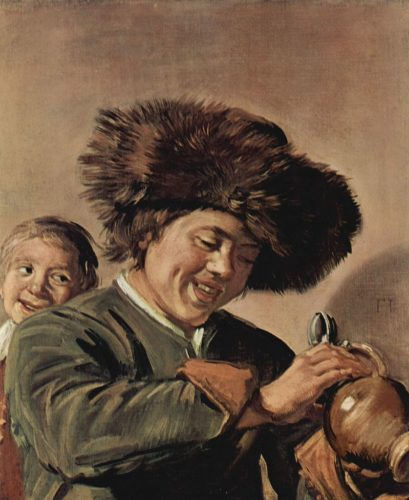 Two laughing boys with a beer mug.