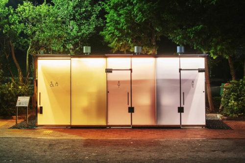 Transparent toilets designed by Shigeru Ban, brightly lit and opaque at night.