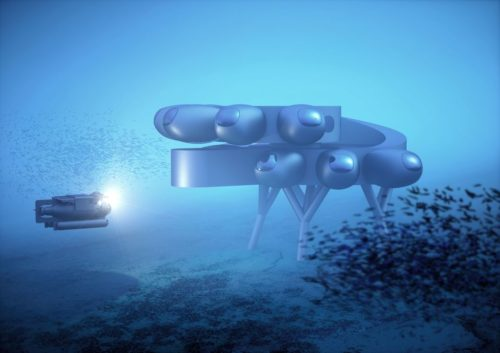 Fabien Cousteau's PROTEUS™. Full view from side with school of fish.