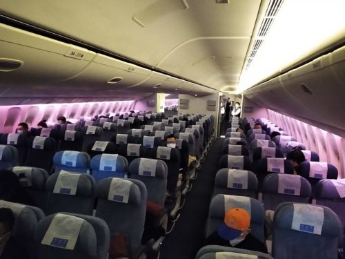 A nearly empty flight from PEK to LAX in March 2020 amid the COVID-19 pandemic
