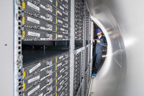 Spencer Fowers, a principal member of technical staff for Microsoft's Special Projects research group, removes a server from the Northern Isles datacenter.