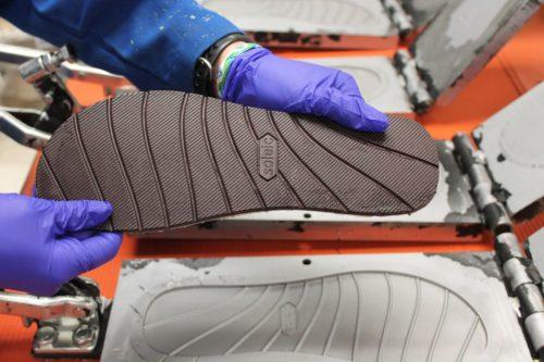 Flip-flop sole made from algae-based polyurethane.