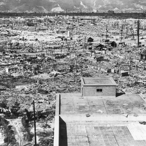 Effects of the atomic bomb on Hiroshima. View from the top of the Red Cross Hospital looking northwest. Frame buildings recently erected. 1945