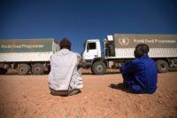 WFP food distribution 10 February 2014. El Fasher: Two World Food Programme (WFP) truck drivers rest while waiting their colleagues to change a flat tire from one of the vehicles of the convoy traveling from El Fasher to Shangil Tobaya, North Darfur.