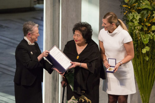 Beatrice Fihn (right) and Hiroshima bombing survivor Setsuko Thurlow, (center) accept the Nobel Peace Prize on Sunday, December 10, 2017.