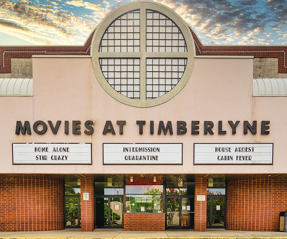 A closed movie theater in North Carolina lists movies related to the coronavirus in August.
