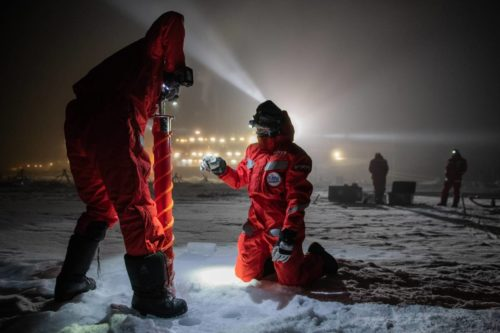 Team BGC science hand over between Leg 1 and Leg 2. Scientific teams conduct scientific hand over. BGC Leg 2 team member Adela Dumitrascu and Partic Simoes Pereira (l)) cores at BGC coring site on MOSAiC ice floe as a part of the scientific handover.