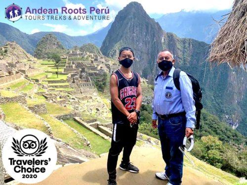 Jesse Katayama at Machu Picchu with a guide.
