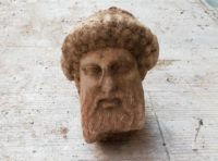 The stone head of Hermes found in a sewer under Athens.