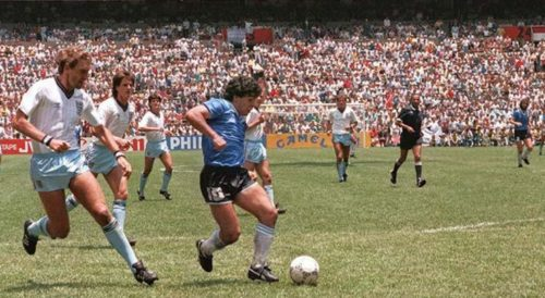 "In 1986, Maradona led Argentina to win the World Cup. In one game, he made a play known as the ""Goal of the Century"", dribbling 66 yards (60 meters) past five opposing players to score."