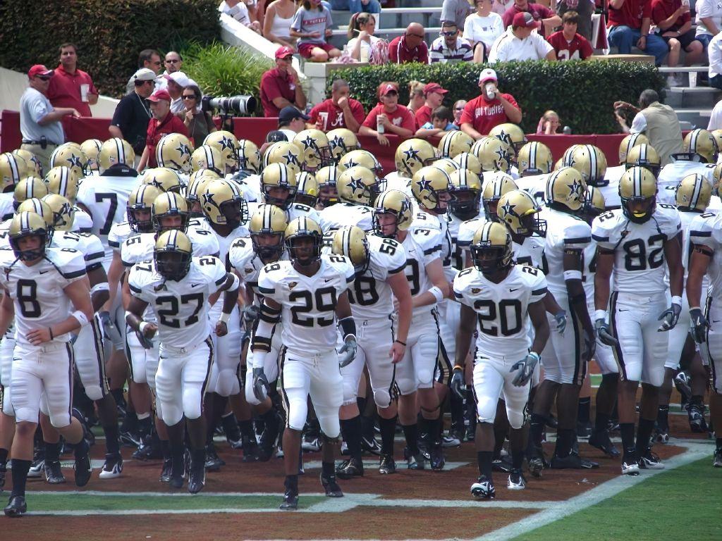 Vanderbilt Commodores football team running onto the field in 2006.