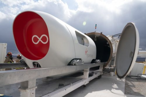 Virgin Hyperloop's XP-2 vehicle in front of the hyperloop tube at the DevLoop test site.