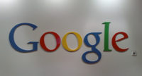 Google logo on a wall inside Google's headquarters in Sydney, Australia.