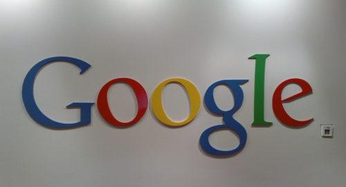 Google logo on a wall inside Google's headquarters in Sydney, Australia.