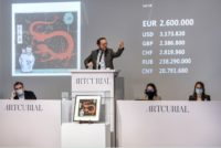 A picture of the auction of Hergé's original cover for The Blue Lotus.