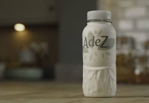 A paper bottle developed by Paboco and Coca-Cola is shown sitting on a counter top. The bottle will be tested this summer in Hungary on the fruit drink brand Adez.