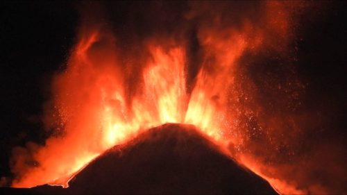 A closeup photo of Mount Etna erupting.