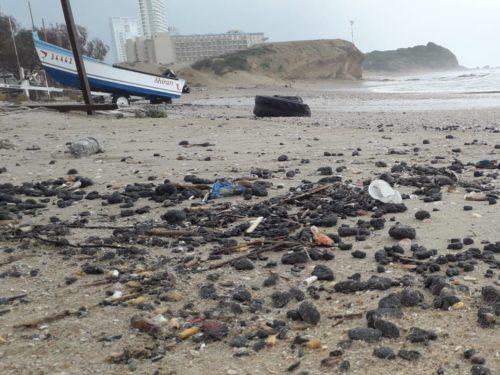 Tar pollution at Hadera Beach.