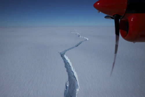 A picture of the crack separating A74 from the Brunt Ice Shelf, taken from an airplane. The plane's propeller can be seen in the upper right of the picture.