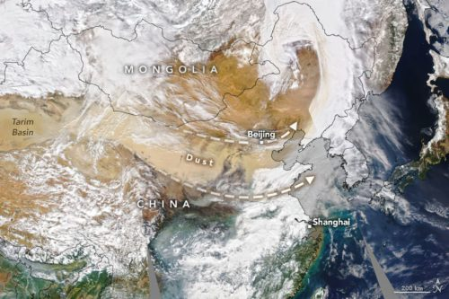 A labeled satellite image shows a dust plume originating from the Taklamakan Desert in northwest China and moving east toward Beijing.