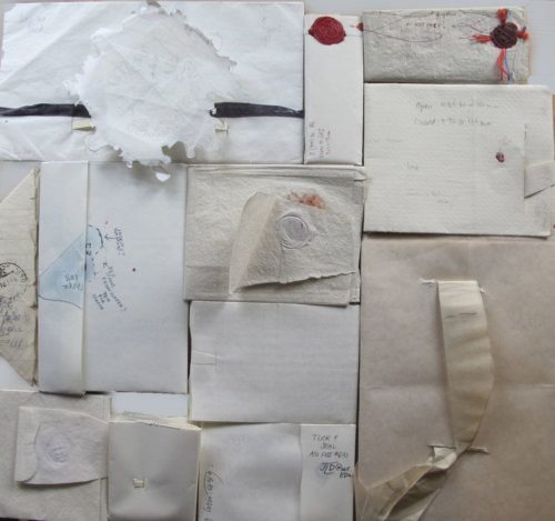 The backs of several letterlocked letters.