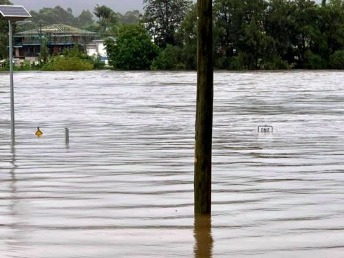 Road signs submerged in Penrith, NSW during the March 2021 floods.