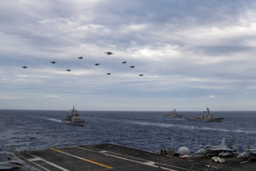 Aircraft assigned to Carrier Air Wing (CVW) 17 fly over the Theodore Roosevelt Carrier Strike Group and the Nimitz Carrier Strike Group in the South China Sea Feb. 9, 2021.