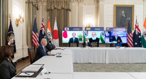 President Joe Biden, joined by Vice President Kamala Harris, Secretary of State Antony Blinken and White House staff, participates in the virtual Quad Summit with Australia, India, and Japan Friday, March 12, 2021, in the State Dining Room of the White House.